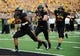 Sept 1, 2012; Columbia, MO, USA; Missouri Tigers defensive lineman Michael Sam (52) runs into the end zone to score against the Southeastern Louisiana Lions while followed by Missouri Tigers defensive lineman Matt Hoch (89) and Russell Hansbrough (32) during the first quarter at Faurot Field. Mandatory Credit: Dak Dillon-USA TODAY Sports