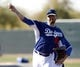 Feb 10, 2014; Glendale, AZ, USA; Los Angeles Dodgers starting pitcher Josh Beckett (61) throws from the bullpen during camp at Camelback Ranch. Mandatory Credit: Rick Scuteri-USA TODAY Sports