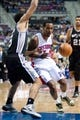 Feb 10, 2014; Auburn Hills, MI, USA; Detroit Pistons point guard Brandon Jennings (7) drives to the basket against San Antonio Spurs point guard Cory Joseph (5) during the first quarter at The Palace of Auburn Hills. Mandatory Credit: Tim Fuller-USA TODAY Sports