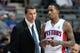 Feb 10, 2014; Auburn Hills, MI, USA; Detroit Pistons interim head coach John Loyer talks to point guard Brandon Jennings (7) during the first quarter against the San Antonio Spurs at The Palace of Auburn Hills. Mandatory Credit: Tim Fuller-USA TODAY Sports