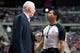 Feb 10, 2014; Auburn Hills, MI, USA; San Antonio Spurs head coach Gregg Popovich talks to referee Bill Kennedy (55) after the second quarter against the Detroit Pistons at The Palace of Auburn Hills. Mandatory Credit: Tim Fuller-USA TODAY Sports
