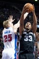 Feb 10, 2014; Auburn Hills, MI, USA; San Antonio Spurs power forward Boris Diaw (33) goes to the basket against Detroit Pistons small forward Kyle Singler (25) during the third quarter at The Palace of Auburn Hills. Pistons won 109-100. Mandatory Credit: Tim Fuller-USA TODAY Sports