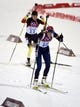 Feb 11, 2014; Krasnaya Polyana, RUSSIA; Tora Berger (NOR, 10) and Evi Sachenbacher-Stehle (GER, 11) compete in the women's 10km pursuit biathlon during the Sochi 2014 Olympic Winter Games at Laura Cross-Country Ski and Biathlon Center. Mandatory Credit: Eric Bolte-USA TODAY Sports