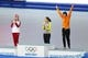 Feb 11, 2014; Sochi, RUSSIA; Margot Boer (NED) (right) celebrates winning the bronze medal in the ladies speed skating 500m at Adler Arena Skating Center during the Sochi 2014 Olympic Winter Games. Also pictured is gold medal winner Sang Hwa Lee (KOR) (center) and silver medal winner Olga Fatkulina (RUS) Mandatory Credit: Jeff Swinger-USA TODAY Sports