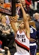 Feb 11, 2014; Portland, OR, USA; Portland Trail Blazers center Robin Lopez (42) dunks over Oklahoma City Thunder small forward Kevin Durant (35) during the third quarter at the Moda Center. Mandatory Credit: Craig Mitchelldyer-USA TODAY Sports