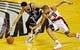 Feb 11, 2014; Portland, OR, USA; Oklahoma City Thunder shooting guard Jeremy Lamb (11) and Portland Trail Blazers small forward Nicolas Batum (88) fight for a loose ball during the third quarter at the Moda Center. Mandatory Credit: Craig Mitchelldyer-USA TODAY Sports