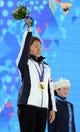 Feb 12, 2014; Sochi, RUSSIA; Sang Hwa Lee (KOR) waves to the crowd after receiving her gold medal during the medal ceremony for the ladies' speedskating 500m during the Sochi 2014 Olympic Winter Games at the Medals Plaza. Mandatory Credit: James Lang-USA TODAY Sports