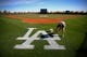 Feb 12, 2014; Glendale, AZ, USA; A groundskeeper paints the Los Angeles Dodgers logo onto a practice field during team workouts at Camelback Ranch. Mandatory Credit: Mark J. Rebilas-USA TODAY Sports