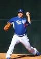 Feb 12, 2014; Glendale, AZ, USA; Los Angeles Dodgers pitcher Jarret Martin throws during team workouts at Camelback Ranch. Mandatory Credit: Mark J. Rebilas-USA TODAY Sports