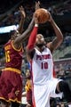 Feb 12, 2014; Auburn Hills, MI, USA; Detroit Pistons power forward Greg Monroe (10) drives to the basket against Cleveland Cavaliers small forward Anthony Bennett (15) during the first quarter at The Palace of Auburn Hills. Mandatory Credit: Tim Fuller-USA TODAY Sports