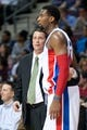 Feb 12, 2014; Auburn Hills, MI, USA; Detroit Pistons head coach John Loyer talks to center Andre Drummond (0) during the second quarter against the Cleveland Cavaliers at The Palace of Auburn Hills. Mandatory Credit: Tim Fuller-USA TODAY Sports
