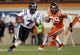 Oct 26, 2013; Blacksburg, VA, USA; Duke Blue Devils quarterback Anthony Boone (7) runs the ball against Virginia Tech Hokies defensive end James Gayle (99) at Lane Stadium. Mandatory Credit: Peter Casey-USA TODAY Sports