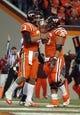 Oct 26, 2013; Blacksburg, VA, USA; Virginia Tech Hokies quarterback Logan Thomas (3) celebrates with Virginia Tech Hokies offensive linesman David Wang (76) against the Duke Blue Devils at Lane Stadium. Mandatory Credit: Peter Casey-USA TODAY Sports