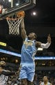 Feb 12, 2014; Minneapolis, MN, USA; Denver Nuggets center J.J. Hickson (7) dunks the ball in the first half against the Minnesota Timberwolves at Target Center. Mandatory Credit: Jesse Johnson-USA TODAY Sports
