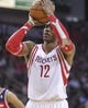 Feb 12, 2014; Houston, TX, USA; Houston Rockets center Dwight Howard (12) attempts a free throw during the second quarter against the Washington Wizards at Toyota Center. Mandatory Credit: Troy Taormina-USA TODAY Sports