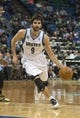 Feb 12, 2014; Minneapolis, MN, USA; Minnesota Timberwolves point guard Ricky Rubio (9) drives to the basket in the second half against the Denver Nuggets at Target Center. The Timberwolves won 117-90. Mandatory Credit: Jesse Johnson-USA TODAY Sports