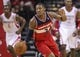 Feb 12, 2014; Houston, TX, USA; Washington Wizards shooting guard Bradley Beal (3) brings the ball up the court during the fourth quarter against the Houston Rockets at Toyota Center. The Rockets defeated the Wizards 113-112. Mandatory Credit: Troy Taormina-USA TODAY Sports