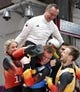 Feb 13, 2014; Krasnaya Polyana, RUSSIA; (From left to right) Germany luge athletes Natalie Geisenberger, Felix Loch, Tobias Wendl, and Tobias Arlt celebrate with German national luge head coach Norbert Loch (top) after winning gold in the luge team relay during the Sochi 2014 Olympic Winter Games at Sanki Sliding Center. Mandatory Credit: Kevin Jairaj-USA TODAY Sports