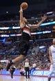 Feb 12, 2014; Los Angeles, CA, USA; Portland Trail Blazers forward Nicolas Batum (88) dunks the ball as Los Angeles Clippers forward Hedo Turkoglu (8) looks on at Staples Center. Mandatory Credit: Kirby Lee-USA TODAY Sports