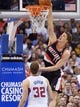 Feb 12, 2014; Los Angeles, CA, USA; Portland Trail Blazers center Meyers Leonard (11) dunks the ball as Los Angeles Clippers forward Blake Griffin (32) defends at Staples Center. The Clippers defeated the Trail Blazers 122-117. Mandatory Credit: Kirby Lee-USA TODAY Sports
