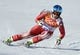 Feb 14, 2014; Krasnaya Polyana, RUSSIA; Beat Feuz (SUI) on his downhill run in the men's super combined during the Sochi 2014 Olympic Winter Games at Rosa Khutor Alpine Center. Mandatory Credit: Eric Bolte-USA TODAY Sports