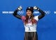 Feb 14, 2014; Krasnaya Polyana, RUSSIA; Noelle Pikus-Pace (USA) celebrates on the podium after winning the silver medal in the ladies skeleton during the Sochi 2014 Olympic Winter Games at Sanki Sliding Center. Mandatory Credit: Kevin Jairaj-USA TODAY Sports