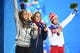 Feb 15, 2014; Sochi, RUSSIA; (Left to right) Noelle Pikus-Pace of the United States of America, Elizabeth Yarnold of Great Britain, and Elena Nikitina of Russia pose for photos during the medal ceremony for Women's Skeleton during the Sochi 2014 Olympic Winter Games at the Medals Plaza. Mandatory Credit: Robert Deutsch-USA TODAY Sports