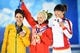 Feb 15, 2014; Sochi, RUSSIA; (Left to right) Lydia Lassila of Australia, Alla Tsuper of Belarus, and Mengtao Xu of China pose for photos during the medal ceremony for Freestyle Skiing Ladies' Aerials during the Sochi 2014 Olympic Winter Games at the Medals Plaza. Mandatory Credit: Robert Deutsch-USA TODAY Sports