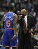 Feb 18, 2014; Memphis, TN, USA; New York Knicks shooting guard Tim Hardaway Jr. (5) is talked to by New York Knicks head coach Mike Woodson during the second quarter against the Memphis Grizzlies at FedExForum. Mandatory Credit: Justin Ford-USA TODAY Sports