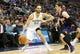 Feb 18, 2014; Denver, CO, USA; Denver Nuggets guard Evan Fournier (94) dribbles against the Phoenix Suns guard Goran Dragic (1)  during the first half at Pepsi Center. Mandatory Credit: Chris Humphreys-USA TODAY Sports