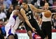 February 18, 2014; Los Angeles, CA, USA; San Antonio Spurs power forward Tim Duncan (21) moves the ball against Los Angeles Clippers center DeAndre Jordan (6) during the first half at Staples Center. Mandatory Credit: Gary A. Vasquez-USA TODAY Sports
