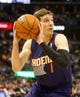 Feb 18, 2014; Denver, CO, USA; Phoenix Suns guard Goran Dragic (1) drives to the basket during the second half against the Denver Nuggets at Pepsi Center.  The Suns won 112-107 in overtime.  Mandatory Credit: Chris Humphreys-USA TODAY Sports