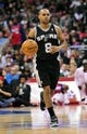 February 18, 2014; Los Angeles, CA, USA; San Antonio Spurs point guard Patty Mills (8) moves the ball up court against the Los Angeles Clippers during the second half at Staples Center. Mandatory Credit: Gary A. Vasquez-USA TODAY Sports
