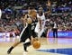 February 18, 2014; Los Angeles, CA, USA; San Antonio Spurs point guard Patty Mills (8) moves to the basket against Los Angeles Clippers point guard Darren Collison (2) during the second half at Staples Center. Mandatory Credit: Gary A. Vasquez-USA TODAY Sports