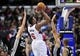 February 18, 2014; Los Angeles, CA, USA; Los Angeles Clippers center DeAndre Jordan (6) shoots a basket against San Antonio Spurs shooting guard Manu Ginobili (20), center Jeff Ayres (11) during the second half at Staples Center. Mandatory Credit: Gary A. Vasquez-USA TODAY Sports