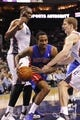 Feb 19, 2014; Charlotte, NC, USA; Detroit Pistons guard Brandon Jennings (7) drives through the defense of Charlotte Bobcats center Al Jefferson (25) and forward Cody Zeller (40) during the first half of the game at Time Warner Cable Arena. Mandatory Credit: Sam Sharpe-USA TODAY Sports