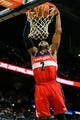 Feb 19, 2014; Atlanta, GA, USA; Washington Wizards point guard John Wall (2) dunks in the first half against the Atlanta Hawks at Philips Arena. Mandatory Credit: Daniel Shirey-USA TODAY Sports