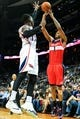 Feb 19, 2014; Atlanta, GA, USA; Washington Wizards small forward Trevor Ariza (1) shoots a three over Atlanta Hawks point guard Dennis Schroder (17) in the first half at Philips Arena. Mandatory Credit: Daniel Shirey-USA TODAY Sports