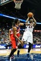 Feb 19, 2014; Atlanta, GA, USA; Atlanta Hawks power forward Elton Brand (42) shoots a basket over Washington Wizards power forward Nene Hilario (42) in the second half at Philips Arena. The Wizards won 114-97. Mandatory Credit: Daniel Shirey-USA TODAY Sports