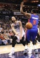 Feb 19, 2014; Charlotte, NC, USA; Charlotte Bobcats forward Josh McRoberts (11) passes the ball as he is defended by Detroit Pistons center Andre Drummond (0) during the second half of the game at Time Warner Cable Arena. Bobcats win 116-98. Mandatory Credit: Sam Sharpe-USA TODAY Sports
