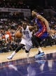 Feb 19, 2014; Charlotte, NC, USA; Charlotte Bobcats guard Kemba Walker (15) drives past Detroit Pistons center Andre Drummond (0) during the second half of the game at Time Warner Cable Arena. Bobcats win 116-98. Mandatory Credit: Sam Sharpe-USA TODAY Sports