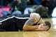 Feb 19, 2014; Salt Lake City, UT, USA; Brooklyn Nets point guard Deron Williams (8) reacts to being injured during the second half against the Utah Jazz at EnergySolutions Arena. The Nets won 105-99. Mandatory Credit: Russ Isabella-USA TODAY Sports