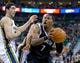 Feb 19, 2014; Salt Lake City, UT, USA; Brooklyn Nets shooting guard Joe Johnson (7) looks to shoot while defended by Utah Jazz center Enes Kanter (0) during the first half at EnergySolutions Arena. The Nets won 105-99. Mandatory Credit: Russ Isabella-USA TODAY Sports