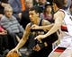 Feb 19, 2014; Portland, OR, USA; San Antonio Spurs shooting guard Danny Green (4) moves to the basket past Portland Trail Blazers power forward Victor Claver (18) during the third quarter at the Moda Center. Mandatory Credit: Craig Mitchelldyer-USA TODAY Sports