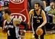 Feb 19, 2014; Portland, OR, USA; San Antonio Spurs shooting guard Marco Belinelli (3) brings the ball up court against the Portland Trail Blazers during the third quarter at the Moda Center. Mandatory Credit: Craig Mitchelldyer-USA TODAY Sports