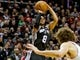 Feb 19, 2014; Portland, OR, USA; San Antonio Spurs point guard Patty Mills (8) shoots against the Portland Trail Blazers during the fourth quarter at the Moda Center. Mandatory Credit: Craig Mitchelldyer-USA TODAY Sports