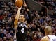 Feb 19, 2014; Portland, OR, USA; San Antonio Spurs shooting guard Danny Green (4) shoots against the Portland Trail Blazers during the fourth quarter at the Moda Center. Mandatory Credit: Craig Mitchelldyer-USA TODAY Sports