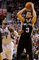 Feb 19, 2014; Portland, OR, USA; San Antonio Spurs shooting guard Marco Belinelli (3) shoots over Portland Trail Blazers shooting guard Wesley Matthews (2) during the fourth quarter at the Moda Center. Mandatory Credit: Craig Mitchelldyer-USA TODAY Sports