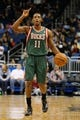 Jan 31, 2014; Orlando, FL, USA; Milwaukee Bucks point guard Brandon Knight (11) calls a play as he dribbles the ball against the Orlando Magic during the first quarter at Amway Center. Mandatory Credit: Kim Klement-USA TODAY Sports