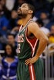 Jan 31, 2014; Orlando, FL, USA; Milwaukee Bucks shooting guard Gary Neal (12) looks up against the Orlando Magic during the first quarter at Amway Center. Mandatory Credit: Kim Klement-USA TODAY Sports
